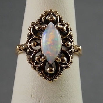 1980s Etruscan Opal Ring one carat Yellow Gold 10K 3.7gm Size 5.5 October Birthstone