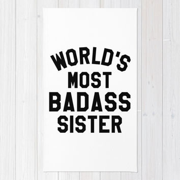 WORLD'S MOST BADASS SISTER Area & Throw Rug by CreativeAngel | Society6