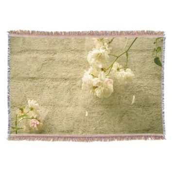 White roses in a cottage garden throw