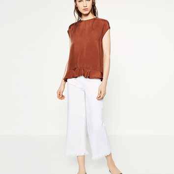 TOP WITH FRILLED HEM