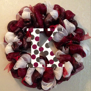 22in deco mesh wreath with letter in the center. Burgundy cream and brown