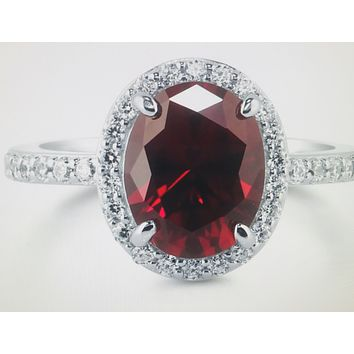 A Perfect 2CT Oval Cut Red Ruby Halo Russian Lab Diamond Ring