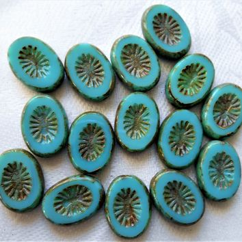 Fifteen 14 x 10mm flat oval Czech glass kiwi beads, opaque turquoise blue green picasso, table cut, carved front & back C05201