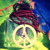 Maroon beadwork handcrafted necklace with wooden peace sign pendant