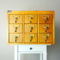 Vintage Library Card Catalog - 9 Drawer Wooden Maple Apothecary Cabinet w. Brass Hardware in Good Condition