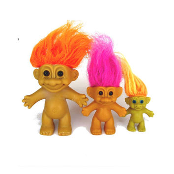 1980s toys. Trolls. Troll dolls. Russ. Vintage trolls. Vintage Russ. Russ berrie. Purple hair. Orange hair. Lot of three naked troll dolls.