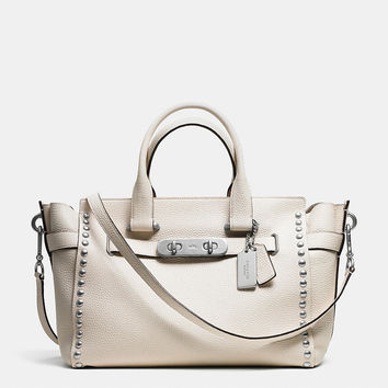 COACH SWAGGER LACQUER RIVET CARRYALL IN PEBBLE LEATHER