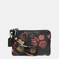 SMALL WRISTLET IN FLORAL PRINT LEATHER