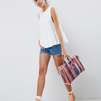 ASOS DESIGN Sleeveless Swing Top With Dropped Armhole And Pephem at asos.com