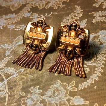 Gold pearl fleur de lis rope dangle earrings. Gold tone, seed pearls, black enamel and fleur design. Clip on. Vintage Hollywood!