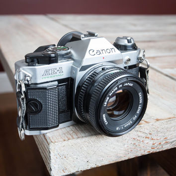 Working Vintage Canon AE-1 Program 35mm Film SLR Camera with Canon 50mm Lens