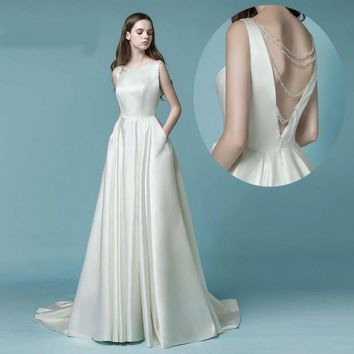 Satin Wedding Dress With Pocket Backless Crystal Bridal Gown