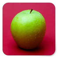 Green apple on red background square sticker