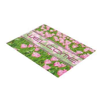 Field of pink tulip flowers doormat