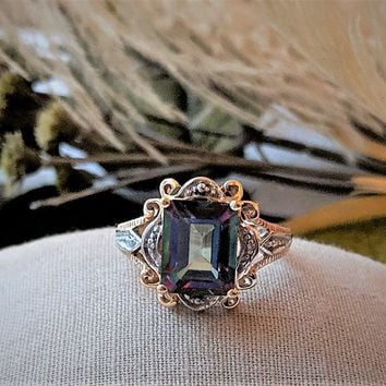 Two-Tone 10k Gold 3ct. Emerald Cut Mystic Topaz/Diamond Ring