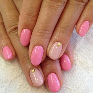 Pink nails with cream ring finger with stud