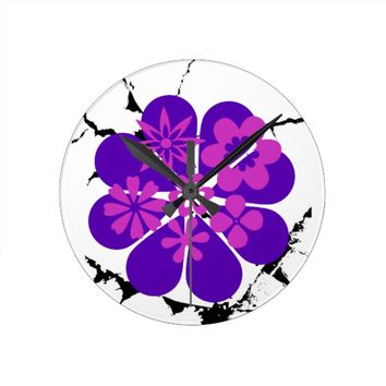 purple and pink flowers round clock