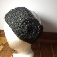 Chunky Knitted headband with crochet flower in black tweed acrylic yarn, button closure, soft, warm, neutral color ear warmer