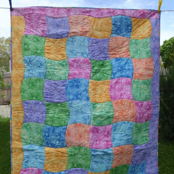 Colorful lap or picnic quilt with floral cotton backing