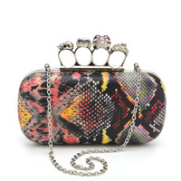 Edgy Snake Skin Knuckle Clutch