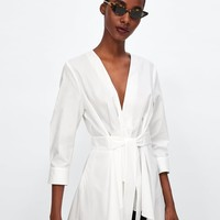 ASYMMETRIC TUNIC WITH BOW DETAILS
