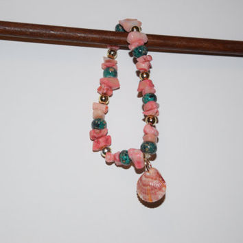 Pink coral with green & gold accent beads, stretch bracelet with natural pink shell charm
