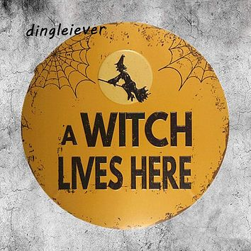 A Witch Lives Here Metal Sign