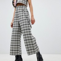 The Ragged Priest cropped wide leg trousers in check at asos.com