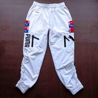 PUMA Fashion new embroidery string mark women and men pants White