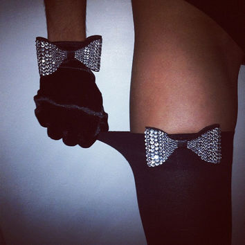unwrap me. black satin gloves or black thigh highs with crystallized bow.