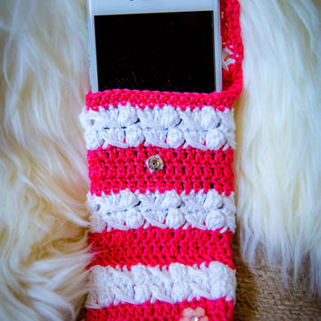 Pink and white crochet cell phone case.