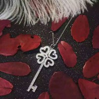 Tiffany & Co. Four-leaf grass diamond key necklace