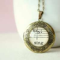 Keepsake locket.  Victorian inspired jewelry made with vintage sheet music under glass. Sing necklace