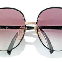 A PAIR OF LARGE SUNGLASSES, CHRISTIAN DIOR, 1990S