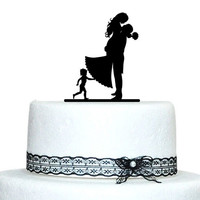 Silhouette bride and groom hug wedding cake topper with a little boy unique cake decoration = 1929416964