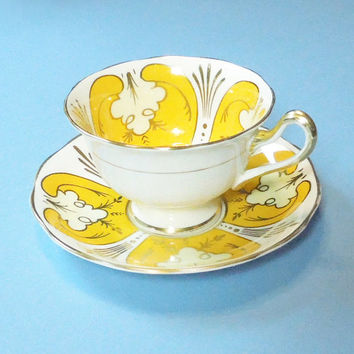Royal Albert Crown China tea cup saucer with yellow gold pattern - Made in England