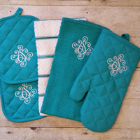 Monogrammed personalized kitchen towel set includes two monogrammed towels, two monogrammed pot holders, and a personalized oven mitt.