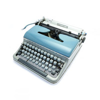 1950s Working Manual Bluebird Torpedo Typewriter in Good Working Condition. Made in Western Germany.
