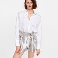 METALLIC-EFFECT BERMUDA SHORTS DETAILS