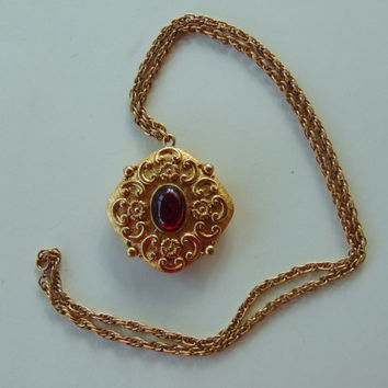 Vintage Revlon Gold tone with Red Crystal Glass Cabochon Intimate Perfume Locket Pendant Necklace