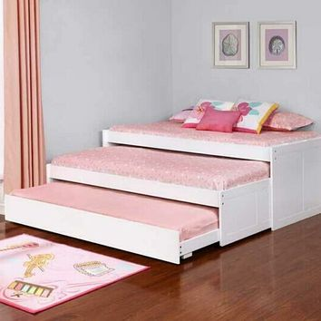 Paneled style white finish wood triple twin day bed with slide out trundles
