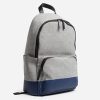 The Dipped Zip Backpack