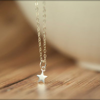 Tiny Star Necklace in Sterling Silver