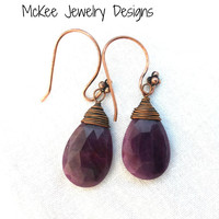 Ruby teardrop faceted gemstone earrings. Copper wire wrapped gemstones.
