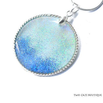 Glitter in resin pendant - blue sparkling necklace