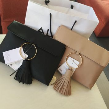 Simply flip over a range of ring tassel Clutch handbag