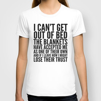I CAN'T GET OUT OF BED THE BLANKETS HAVE ACCEPTED ME AS ONE OF THEIR OWN T-shirt by CreativeAngel