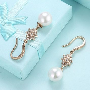Swarovski Crystal Star Shaped Dangling Classic Pearl Dangling Earrings Set in 18K Gold
