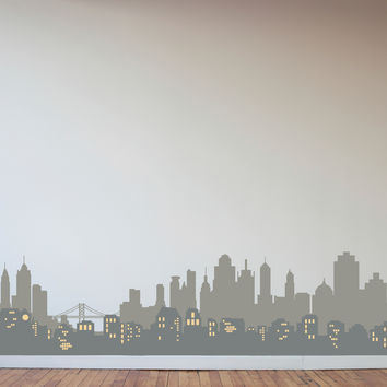 Layered City Skyline Silhouette with City Lights