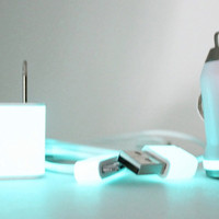 White iPhone accessories with rhinestones on Teal Glow in the Dark charger set